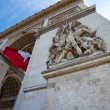 Stock Photo: Detail of Arc de Triomphe with French Flag