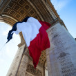 Stock Photo: Detail of Waving French Flag at Arc de Triomphe