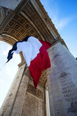 Detail of Waving French Flag at Arc de Triomphe — Stock Photo