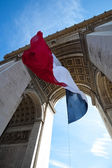 Waving French Flag at Arc de Triomphe — Stock Photo