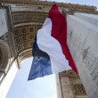 Stock Photo: French Flag Waving in Arc de Triomphe