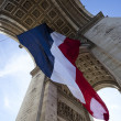 Royalty-Free Stock Photo: Arc de Triomphe with French Flag