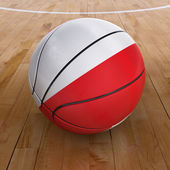 Bola de basquete com bandeira polonesa — Fotografia Stock