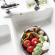 Modern Sink With Fresh Food - Stock Photo