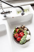 Modern Sink With Fresh Food — Stock Photo