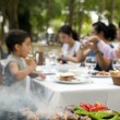 Stock Photo: Big Family Barbecue in the Garden