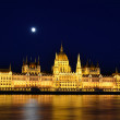Budapest Parliament at night with the full moon in the sky — Stock Photo