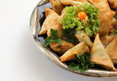 Indian samosas in a bowl — Stock Photo