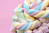 Pastel colored marshmallow sweets with pink background — Stock Photo