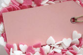 Pink empty label in sweet hearts — Stock Photo
