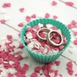 Wedding rings in sweet sugar hearts - Stock Photo