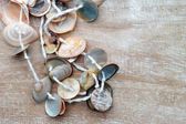 Necklace made of small seashells — Stock Photo