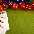 The dice and playing cards on green background. — Stock Photo