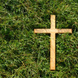 Cross on grass — Stock Photo