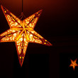 Yellow lamp in the form of a holiday star — Stock Photo