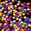 Golden confetti stars — Stock Photo
