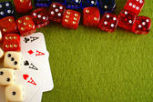 The dice and playing cards on green background. — Stockfoto