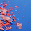 American flags decorate background including stars — Stock Photo