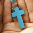 Stock Photo: Hand holding blue rosary