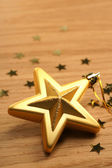 Gold five pointed star christmas decoration for haging on tree — Stock Photo