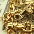Gold and Money turning viewed from an unusual angle — Stock Video