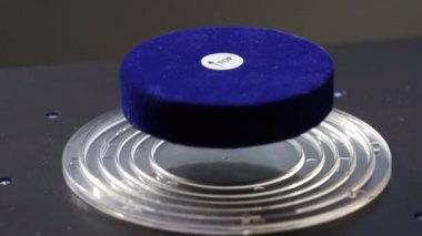 Magnet floating in a magnetic field Science Experiment — Stock Video