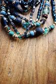 Beads necklace on wood background — Stock Photo