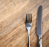 Table background with fork and knife — Stock Photo
