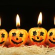 Cute pumpkin candles for halloween — Stock Photo