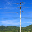Electric pole on a blue sky background — Stock Photo