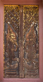 Door woodcarving in temple, Thailand — Stok fotoğraf