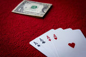 Four aces  on red background — Stock Photo