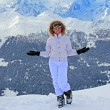 Girl  on the snow in mountains — Stock Photo