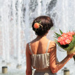 Stock Photo: Fashion girl with bunch of flowers