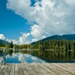 Wharf by the Schwarzsee in Austria with mirror reflection of the landscape — Stock Photo