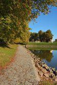 Path in autumn near water in Nymburk city — Stockfoto