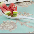 Stock Photo: Watermelon Wedges in floral background