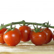 Tomatoes on white background, and wood — Stock Photo