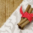 Cinnamon stick and red riboon — Stock Photo