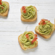 Toast, guacamole and tomato — Stock Photo