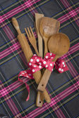 Wooden spoons,pink tape lunar white wood background. — Stock Photo