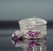Silver bracelet with pink crystal stones and ring. — Stock Photo