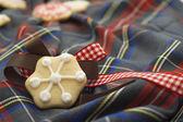 Christmas cookies on red and bule tartan — Стоковое фото
