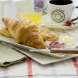 Breakfast croissant and cup — Stock Photo