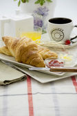 Breakfast croissant and cup — Photo