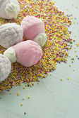 Marshmallow in form of strawberries, and sugar balls — Stock Photo