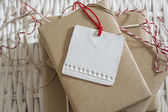 Gift box wrapped in recycled paper with label — Zdjęcie stockowe