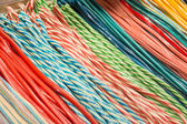 Pile of colorful fruit laces candy, store in a market in the cit — Stock Photo