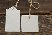 Blank tag,  rectangular and square, on wooden background  — Stock Photo