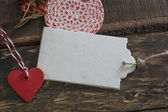 White tag, red heart and round label , on wood  background  — 图库照片